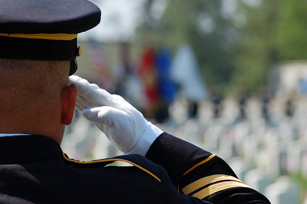 soldier salutes fallen comrades - marines stock photos and pictures