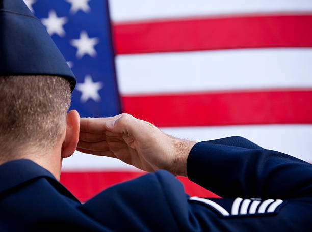 soldier saluting american flag - saluting stock photos and pictures