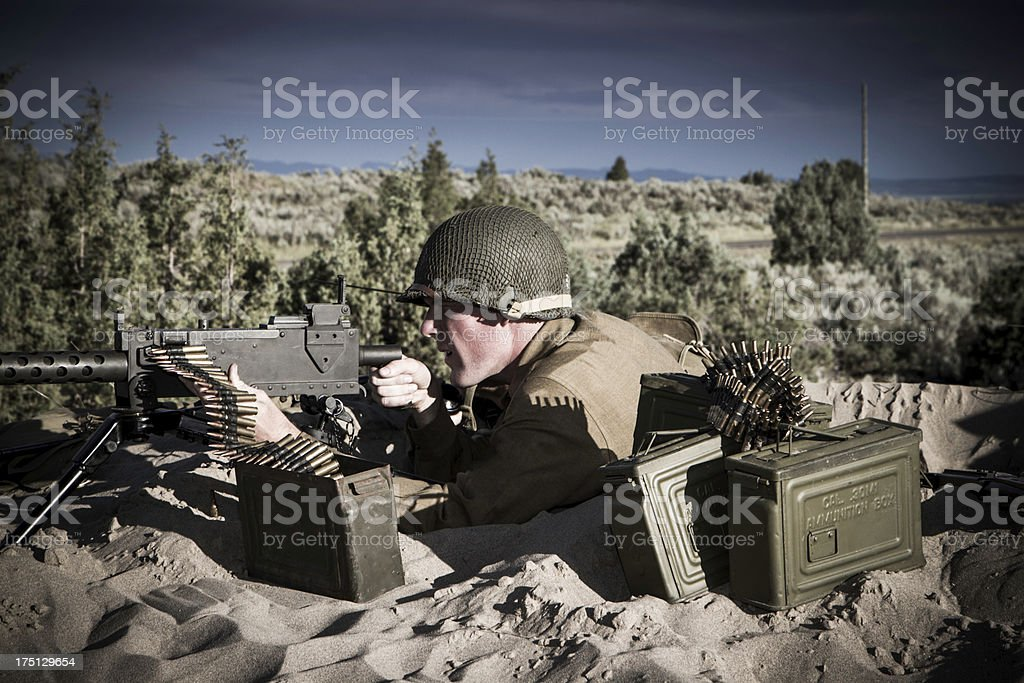 WWII Soldier Shooting From A Foxhole royalty-free stock photo