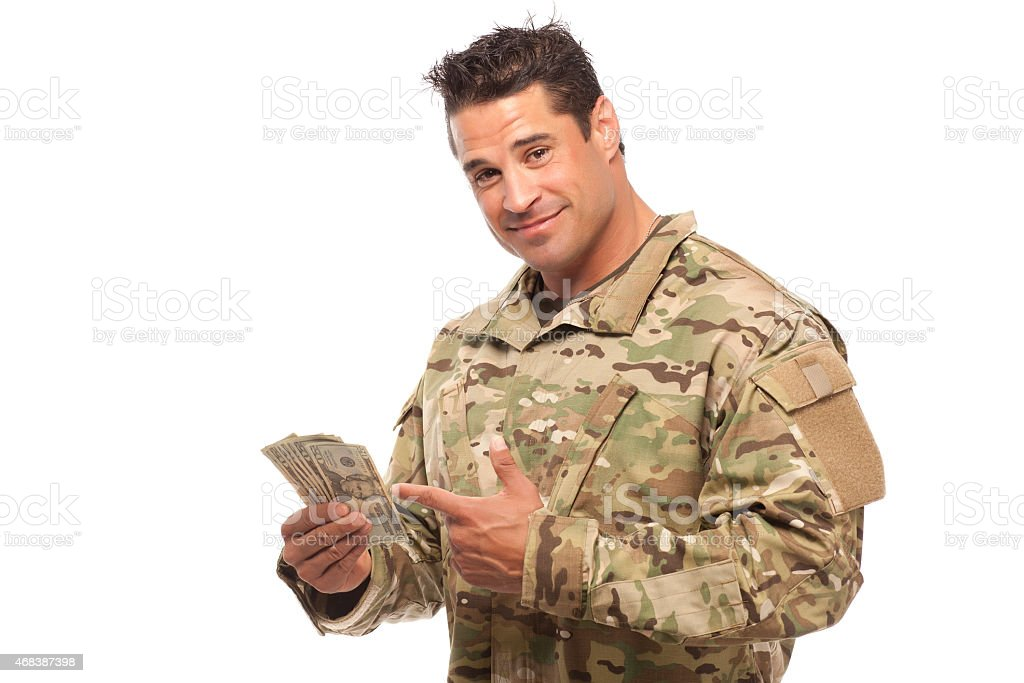 Soldier showing money stock photo