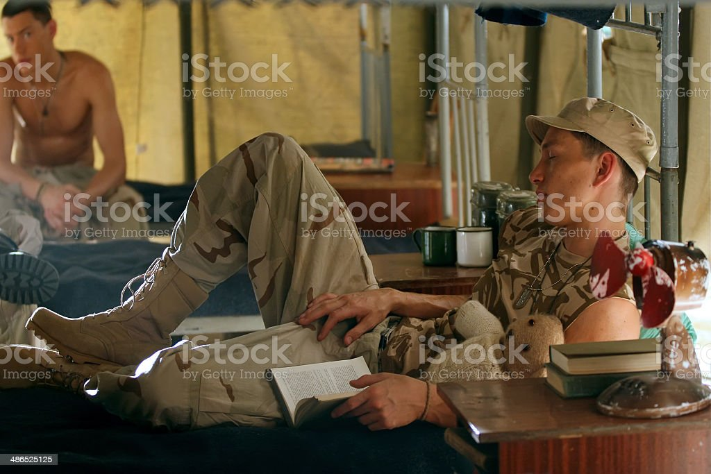 Soldier sleeping in a barrack stock photo