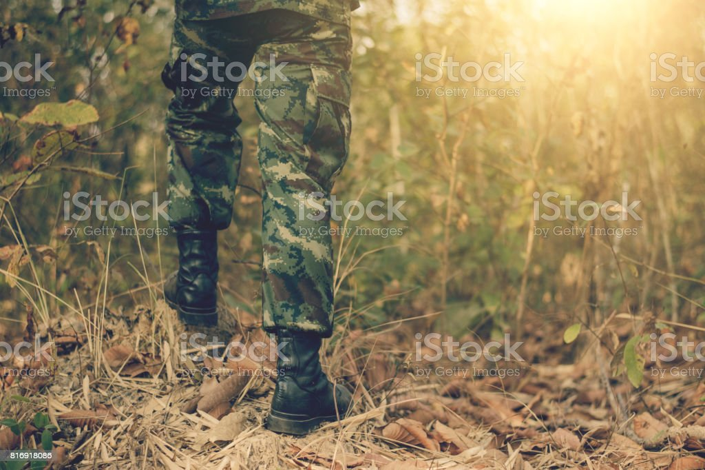 Soldier stand on the rock in nature background stock photo