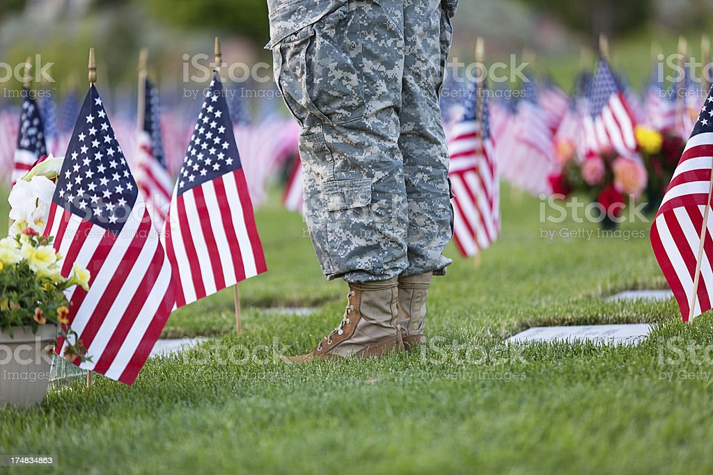 Soldier standing at cemetary stock photo