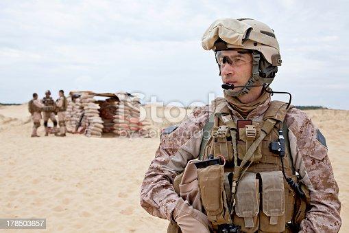 istock Soldier standing in the desert 178503657