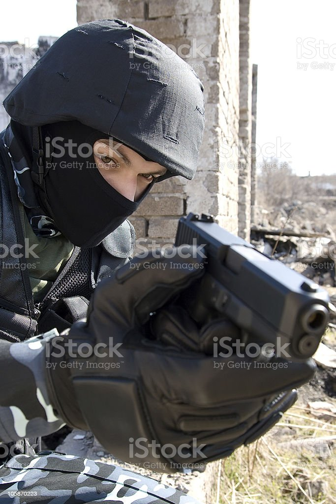 Soldier targeting with a glock pistol royalty-free stock photo