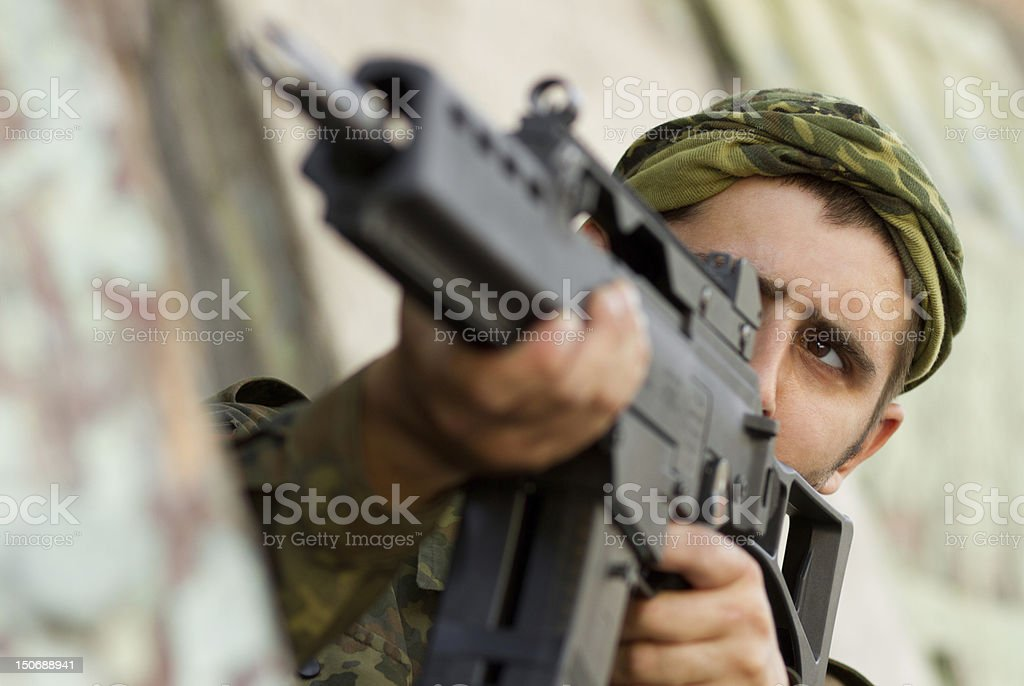 Soldier targeting with a rifle stock photo