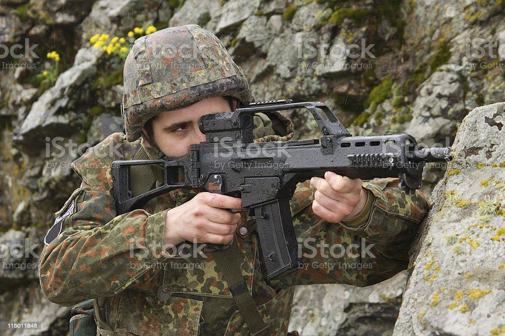 Soldier targeting with automatic rifle royalty-free stock photo