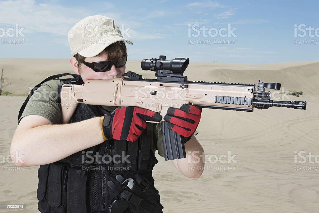 Soldier training with military grade weapon in desert royalty-free stock photo