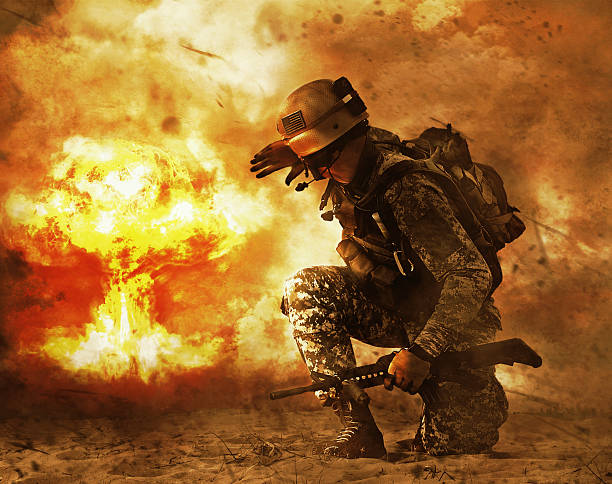 soldier turning to mushroom cloud US soldier in the desert during the military operation turning to nuclear explosion mushroom cloud covering his eyes. He is doomed battlefield stock pictures, royalty-free photos & images