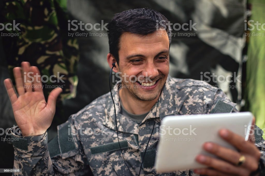 Soldier using digital tablet stock photo