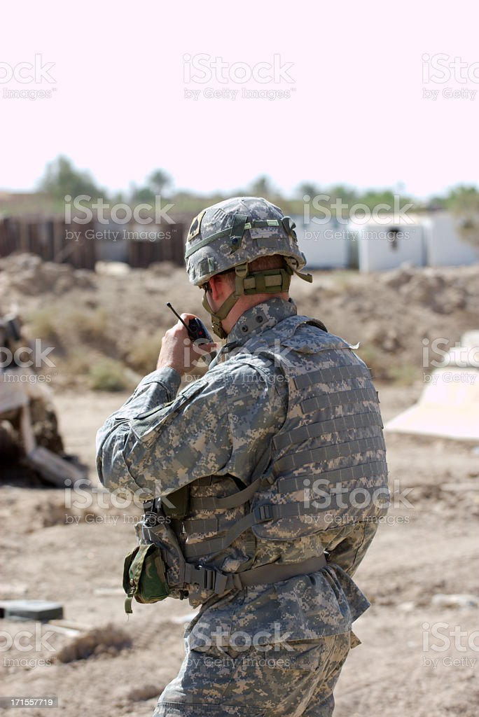 Soldier using radio to communicate stock photo