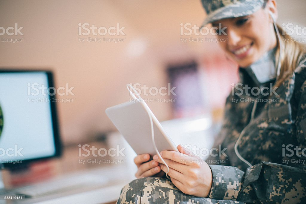 Soldier using tablet stock photo