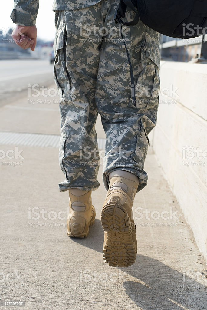 Soldier walking stock photo