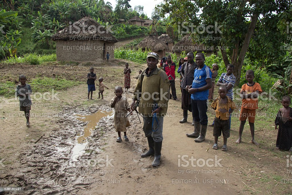 FDLR Soldier walking with Rwandan Refugees stock photo