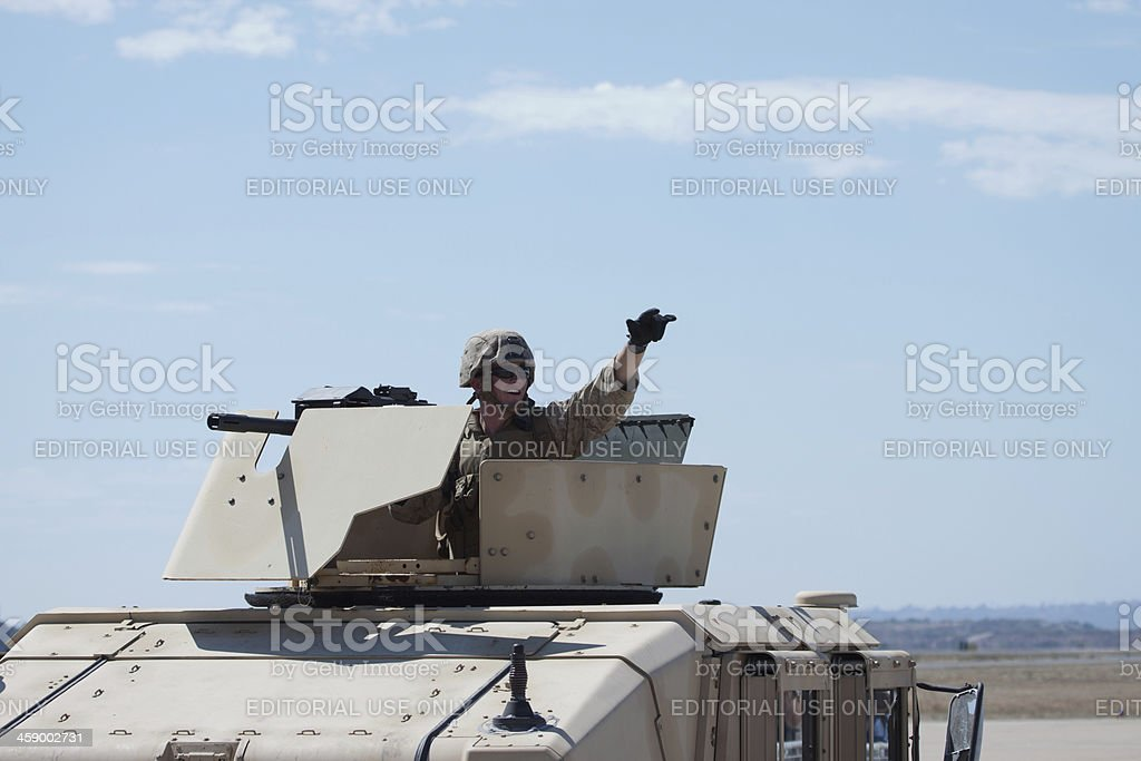 Soldier Waving From Humvee stock photo