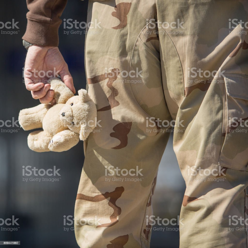 Soldier with a toy stock photo