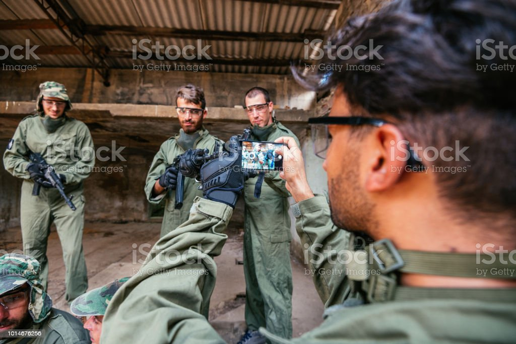 Soldier with airsoft gun resting after battle stock photo