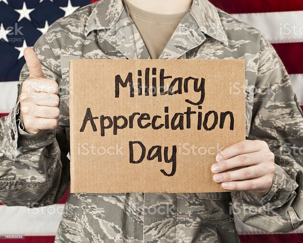 Soldier with Appreciation Day Sign stock photo