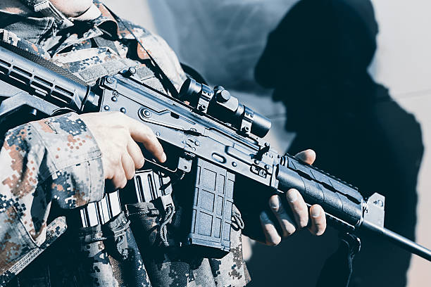 Soldier with assault rifle, officer give orders Soldier with assault rifle, officer give orders antiterrorist stock pictures, royalty-free photos & images