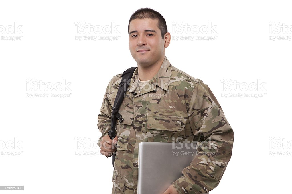 Soldier with backpack and laptop royalty-free stock photo