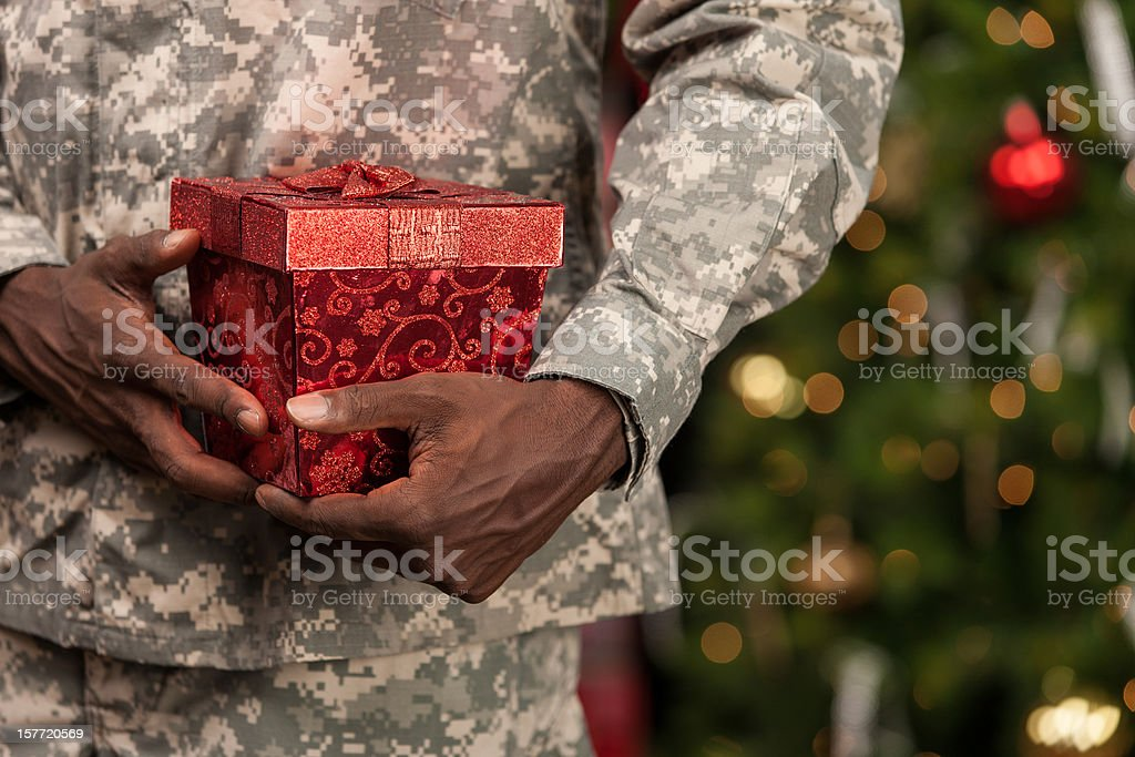 Soldier with Christmas Gift stock photo