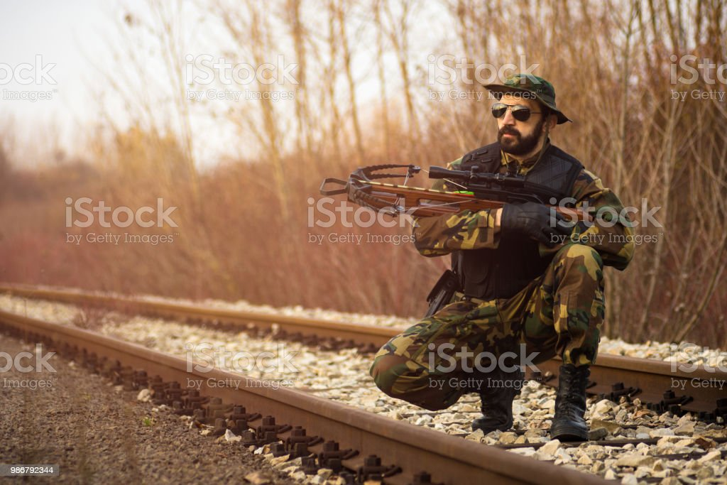 soldier with crossbow stock photo