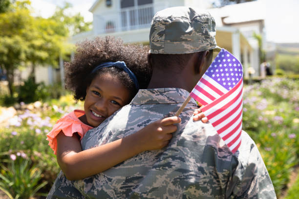 Soldier with daughter stock photo