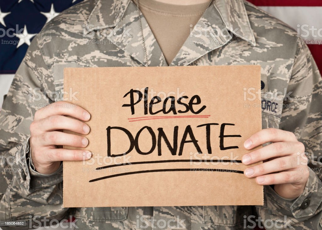 Soldier with Donate Sign royalty-free stock photo