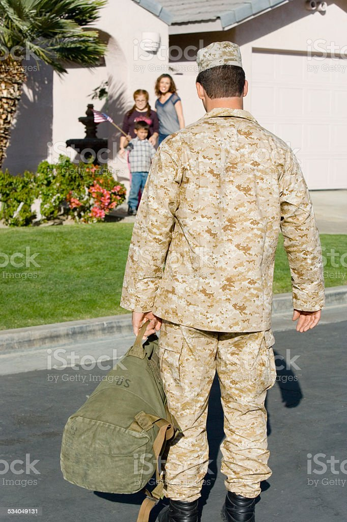 Soldier with family stock photo