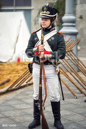 istock Soldier with gun. 609719430