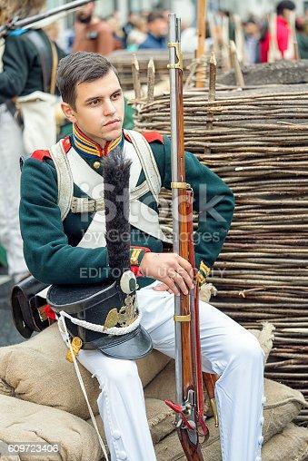 istock Soldier with gun. 609723406