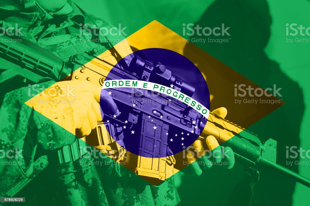 Soldier with machine gun with national flag of Brasil stock photo