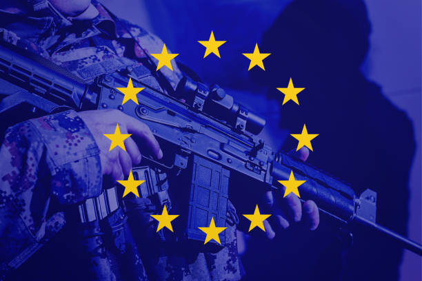Soldier with machine gun with national flag of European Union stock photo
