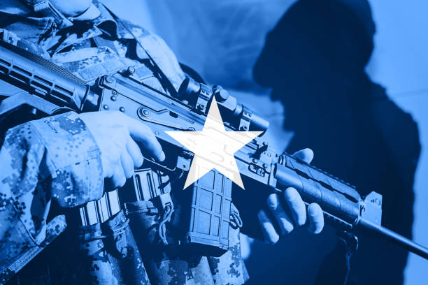 soldier with machine gun with national flag of somalia - horn of africa stock photos and pictures