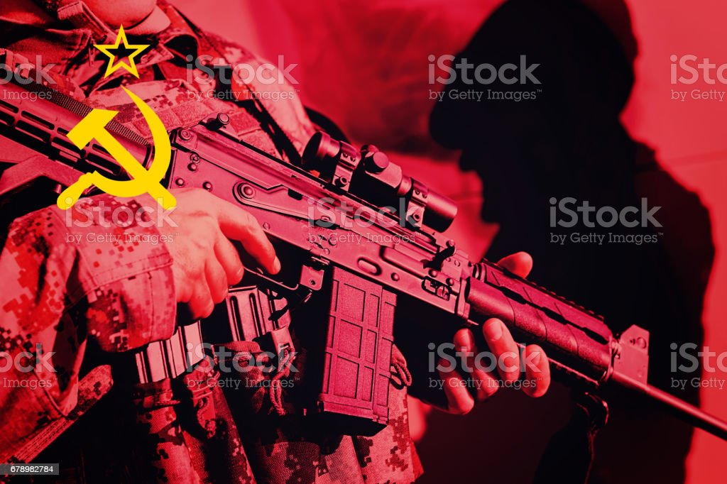 Soldier with machine gun with national flag of SSSR stock photo