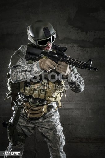 istock Soldier with mask aiming a rifle 465543757