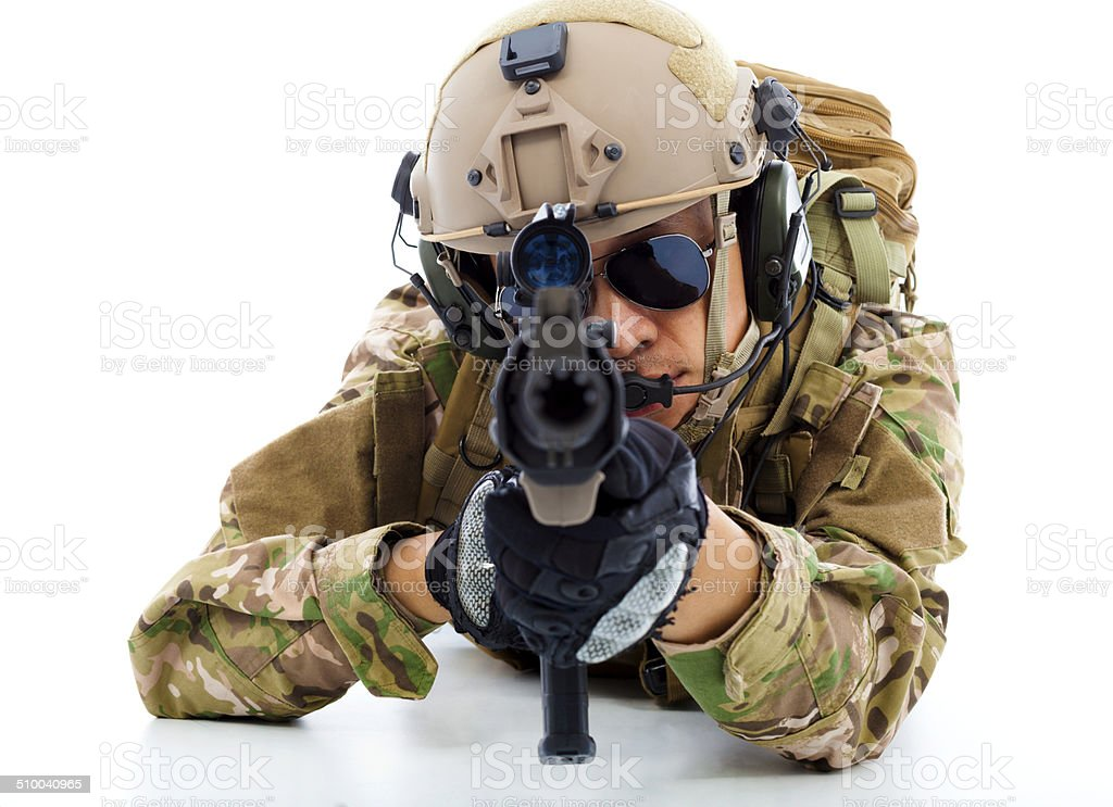 Soldier with rifle and lying on floor over white background stock photo