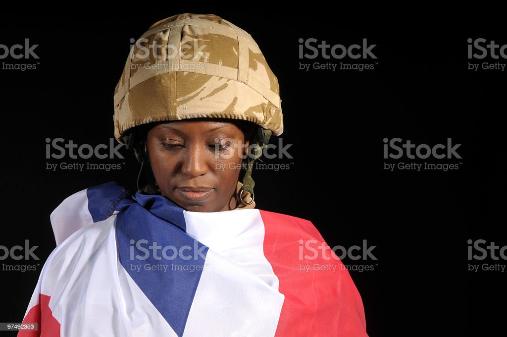 Soldier wrapped in the Union Jack flag royalty-free stock photo