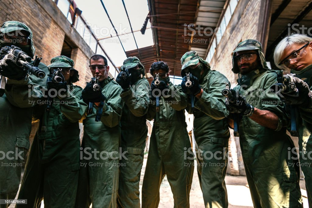 Soldiers aiming their weapons stock photo