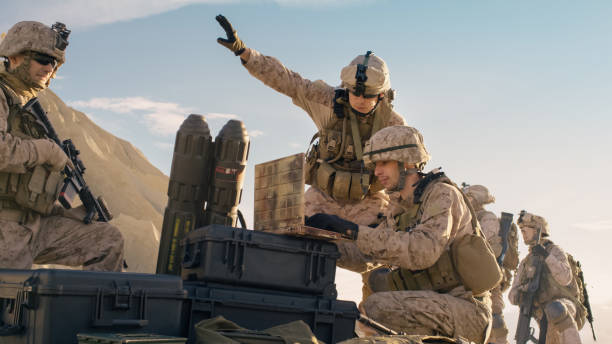 Soldiers are Using Laptop Computer for Surveillance During Military Operation in the Desert. Soldiers are Using Laptop Computer for Surveillance During Military Operation in the Desert. advanced tactical fighter stock pictures, royalty-free photos & images