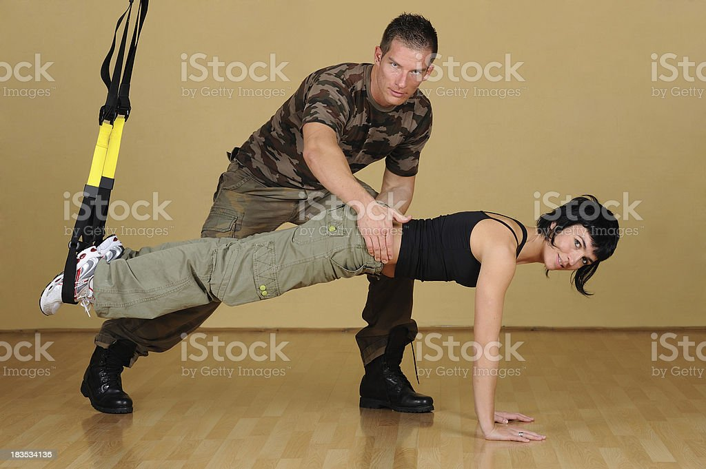 Soldiers at suspension training stock photo