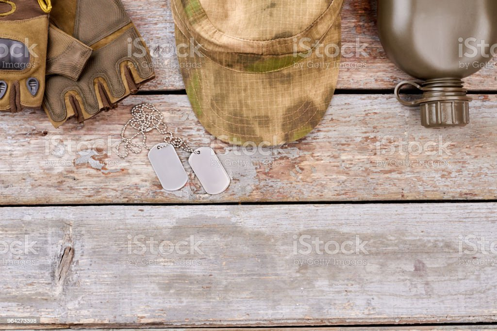 Soldier's attributes on wood. stock photo