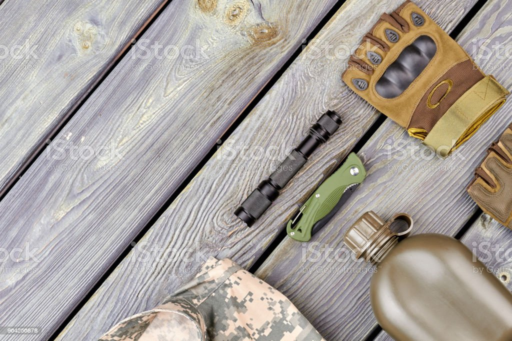 Soldiers attributes on wood with copyspace. stock photo