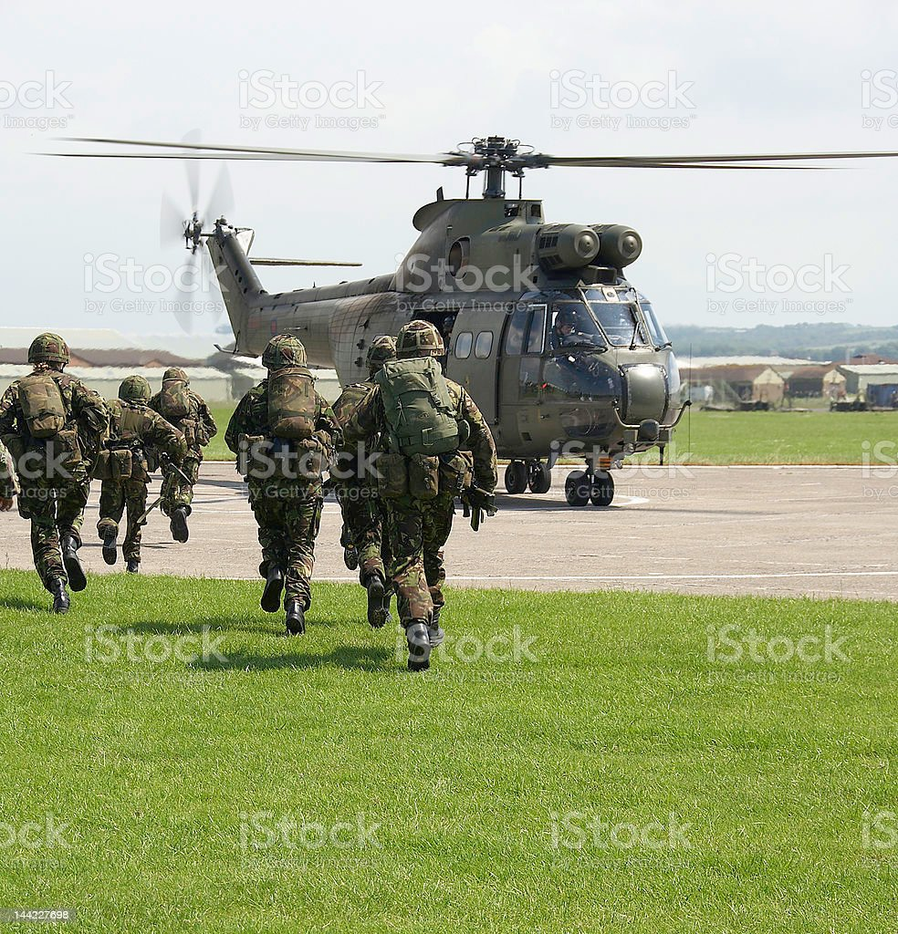 UK soldiers board puma helicopter stock photo