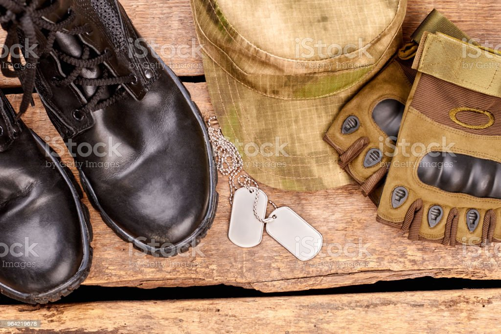 Soldier's clothes and attributes flat lay. stock photo