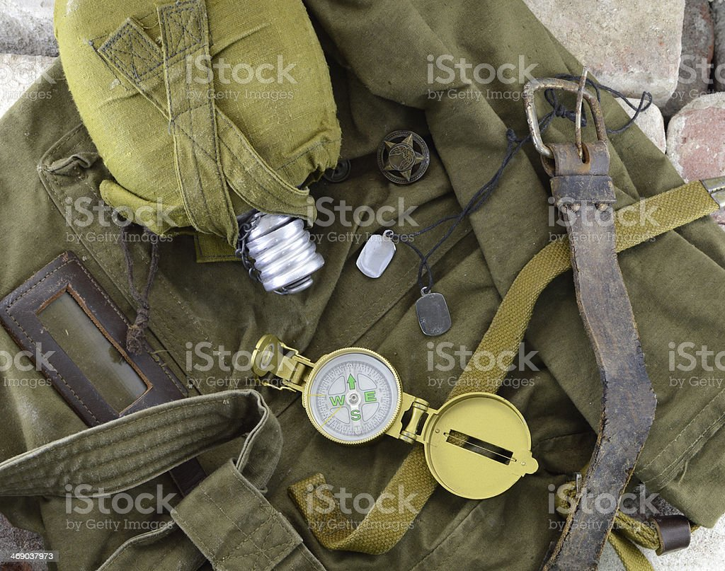 Soldier's flask, compass and other military tools stock photo