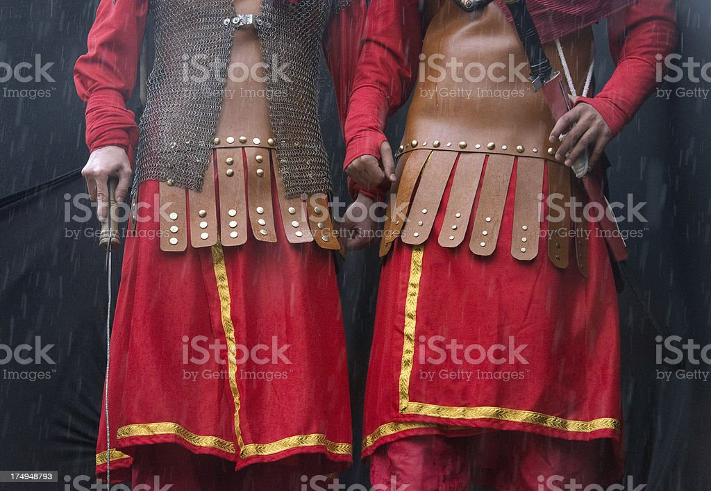 Soldiers holding swords royalty-free stock photo