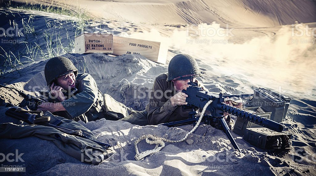 WWII Soldiers In A Foxhole With Explosions Nearby royalty-free stock photo