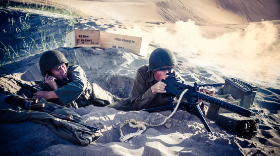 istock WWII Soldiers In A Foxhole With Explosions Nearby 175181317