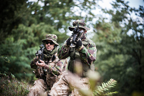 soldiers in action - uk military stock photos and pictures
